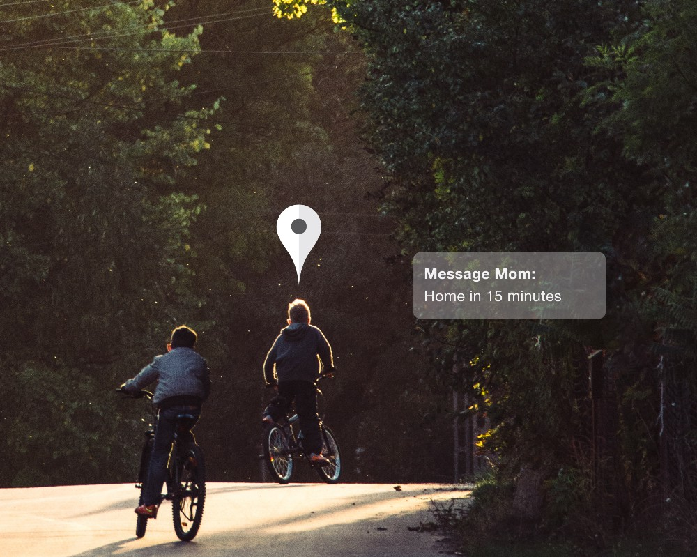 Children riding bikes with a pop-up text message from mom