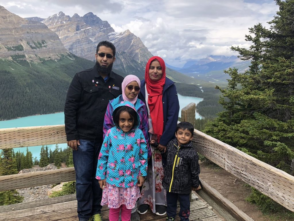 Uzair with his family in Banff.