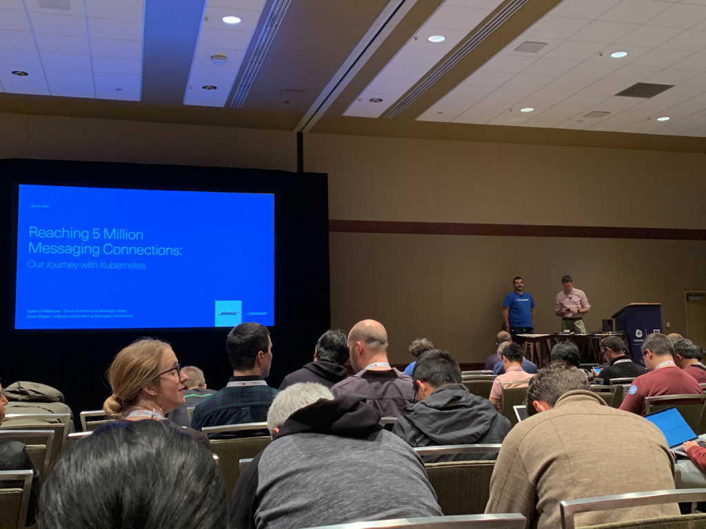 Dave and Bose's Dylan O'Mahony gearing up to present to a full crowd at KubeCon