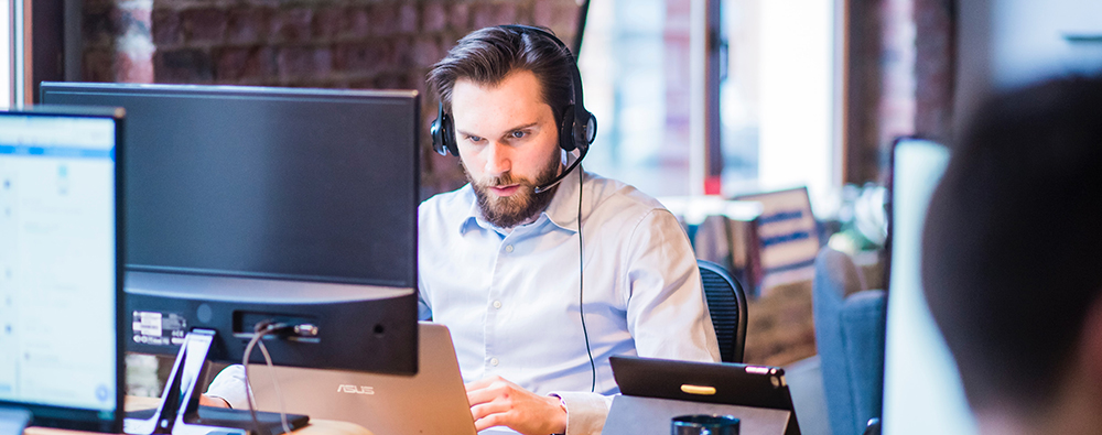 male employee working at computer
